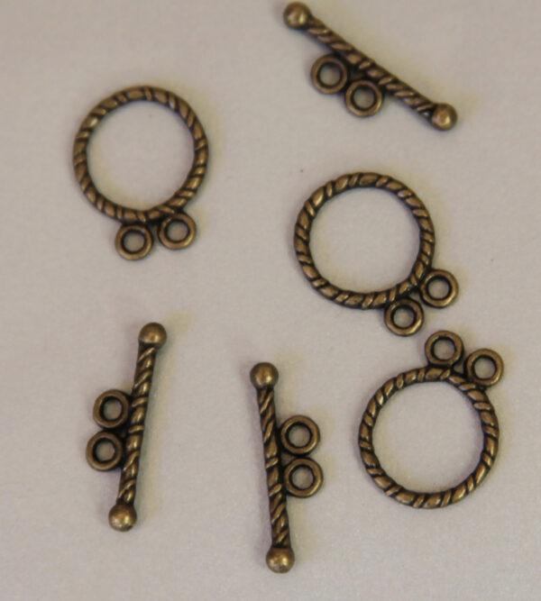 chiusure a t torciglione color bronzo bigiotteria hobby creativi 1