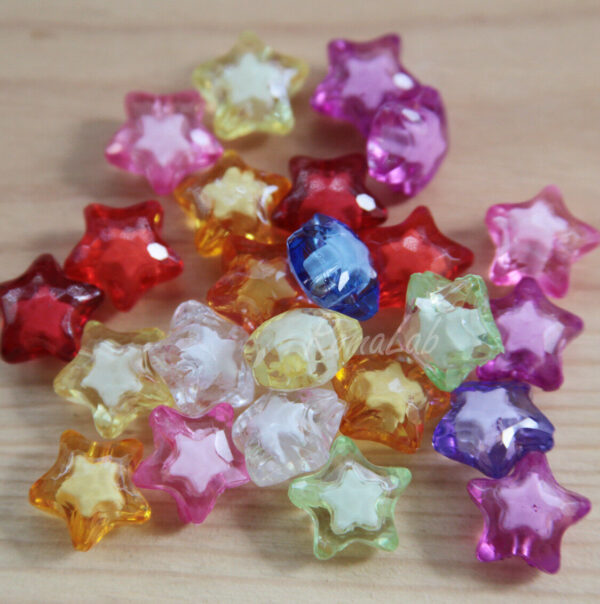 5 PERLE in acrilico a forma di stelle 20MM TRASPARENTI LUMINOSE star SFACCETTATE 302702826510