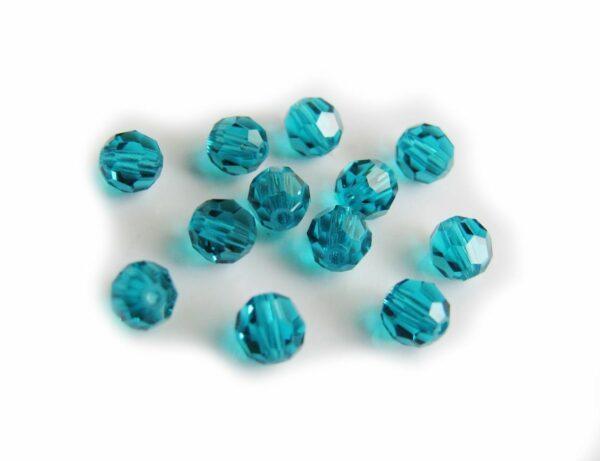 12 CRISTALLI ORIGINALI SWAROVSKI ROUND TONDO 4 MM blue zircon 292912290301